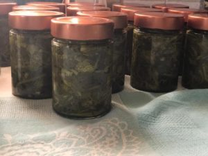 Broccoli is placed in the jars.